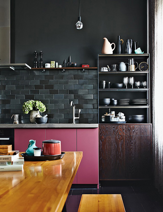 I adore this all black kitchen! The raspberry pink cabinets are chic and completely unexpected. Spotted on SoFreshAndSoChic.com #sofreshandsochic #blackkitchen #pinkcabinets #masculinedesign #modern
