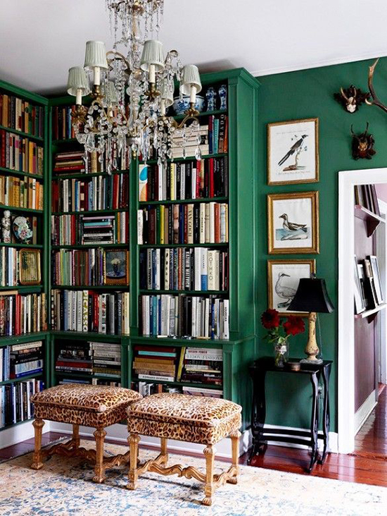 Emerald green library- this is one of my favourite rooms. The chandelier, the leopard stools, the artwork- it's all so eclectic and so luxe. Spotted on SoFreshAndSoChic.com #sofreshandsochic #emeraldgreen #library #crystal #leopardprint #luxe #eclectic