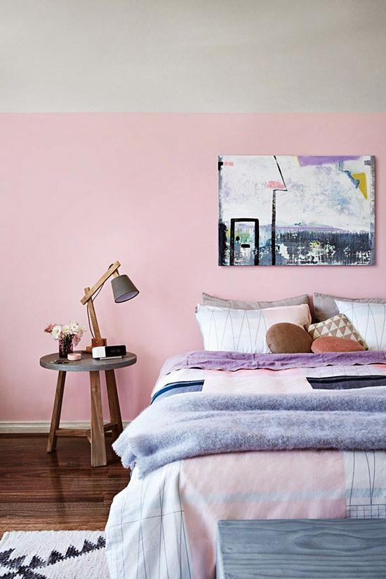 Pink half-painted wall in bedroom.