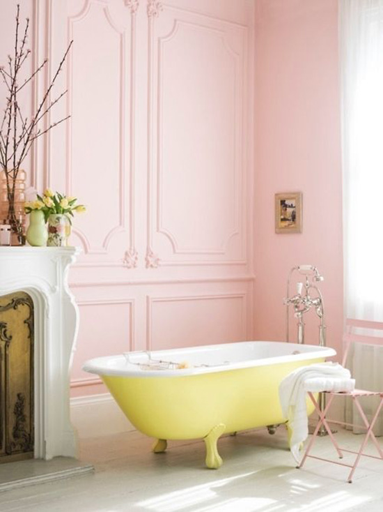 Pastel pink bathroom with a gorgeous lemon yellow clawfoot tub.
