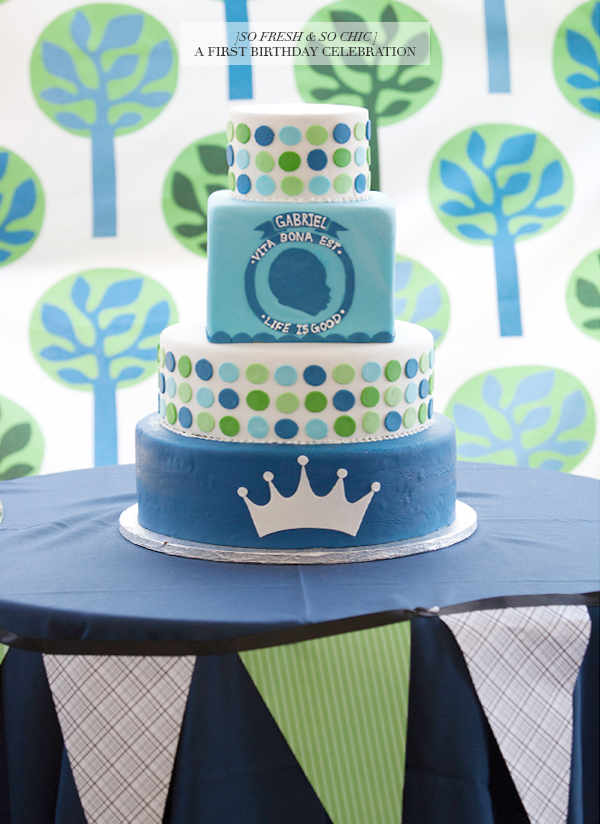 So Fresh & So Chic // A First Birthday Celebration: Three-Tier blue, white, and green birthday cake with silhouette, crown and polka dots // www.sofreshandsochic.com // #sofreshandsochic