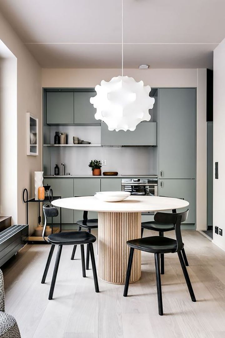 So Fresh & So Chic // Scandinavian kitchen with light walls and floors, pale grey cabinets, and gorgeous round dining table. - #homedecor #interiordesign #scandinavian #sofreshandsochic
