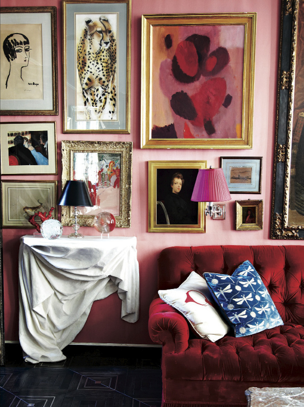 So Fresh & So Chic // Pink and Red Interiors // Bohemian living room design with gallery wall, pink walls, red sofa