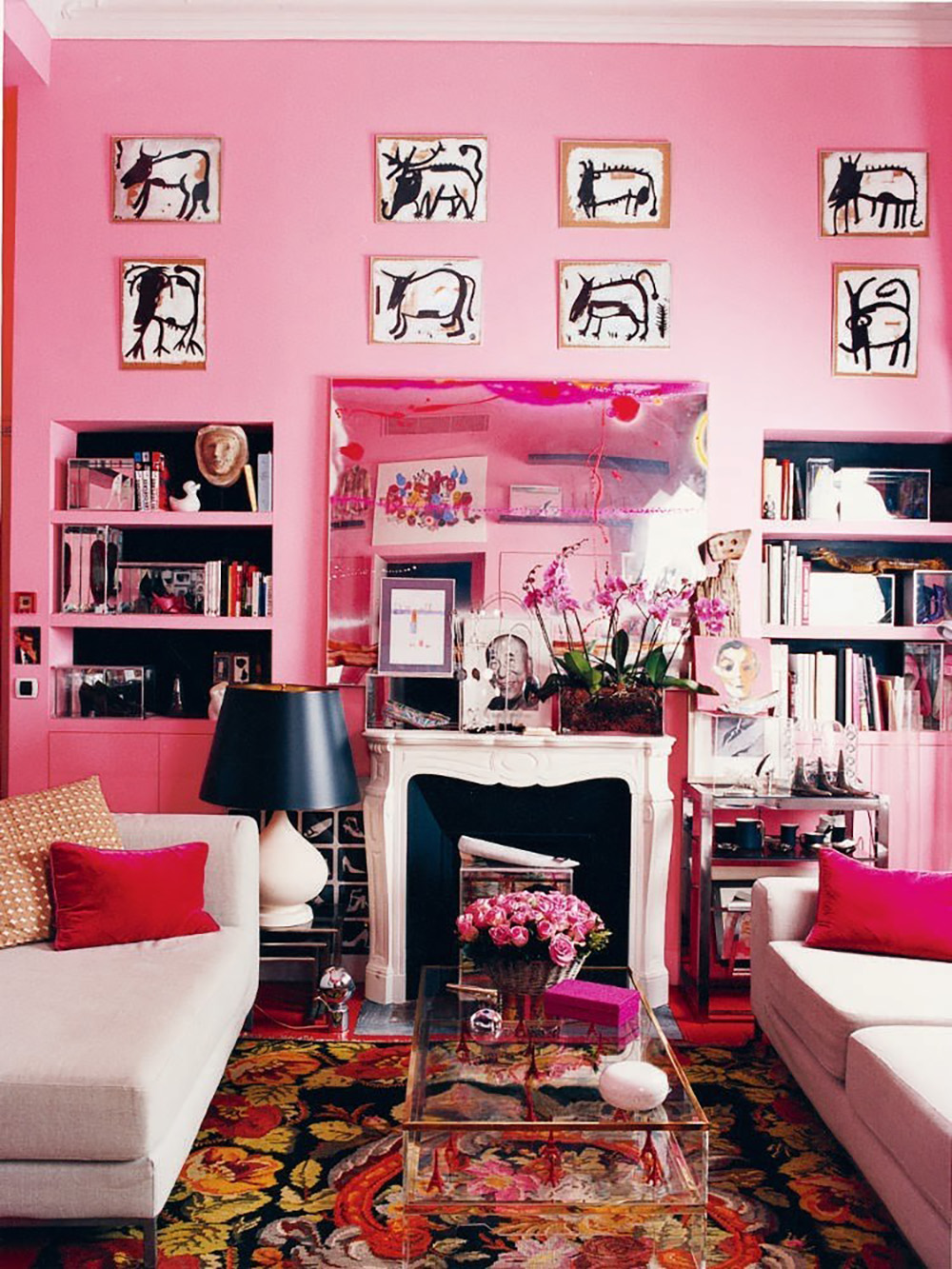So Fresh & So Chic // Pink and Red Interiors // Bubblegum pink walls in living room with black, beige, and red accents