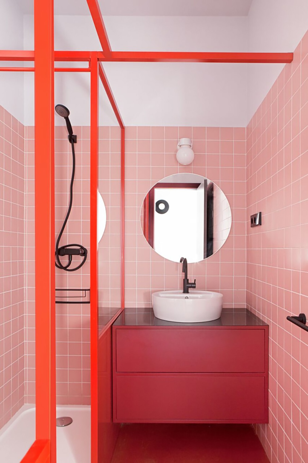 So Fresh & So Chic // Pink and Red Interiors // Pink tiles and red shower door frame and vanity in a pink and red bathroom