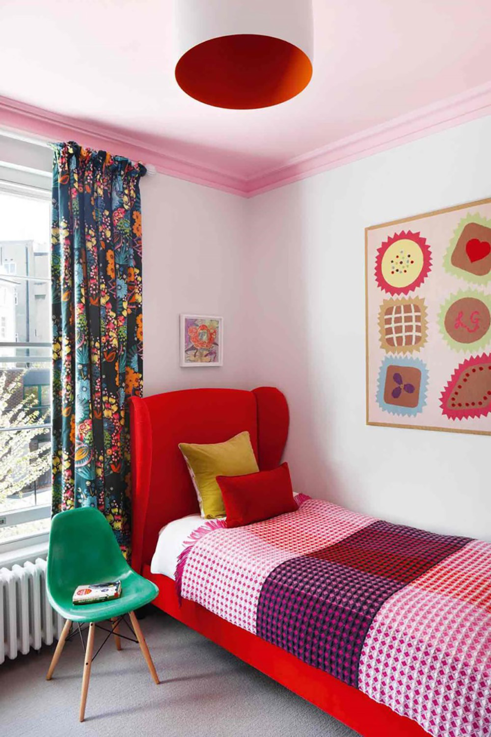 So Fresh & So Chic // Pink and Red Interiors // Adorable kids room with pink ceiling, red upholstered bed, and green accent chair.