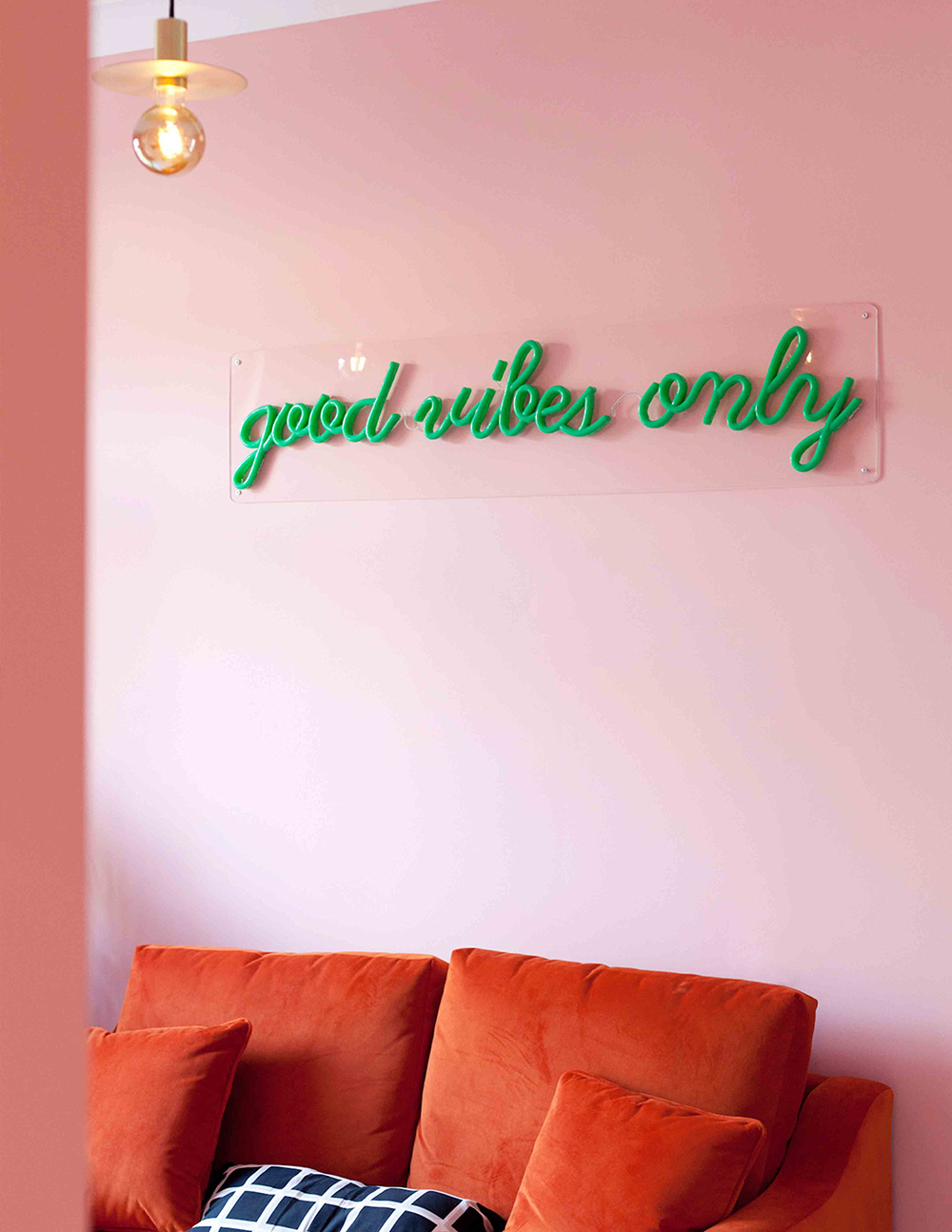 "So Fresh & So Chic // Pink and Red Interiors // Red and pink living room with green neon light that says ""good vibes only"""