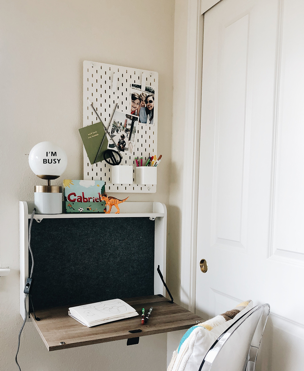 Wall mounted desk and pegboard for a small space kids room!