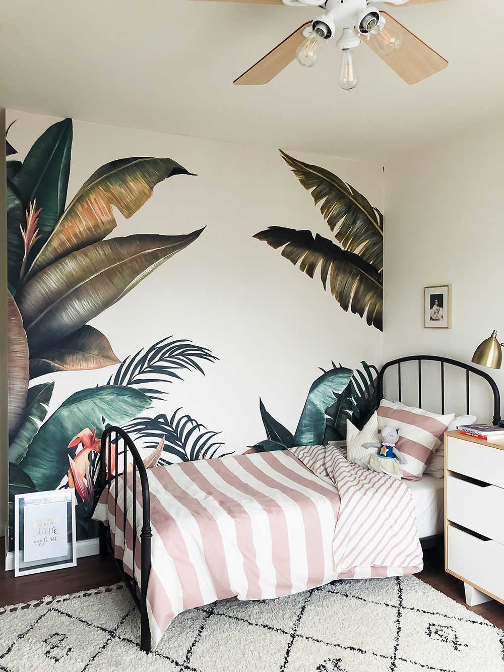 Tropical by Lemon wallpaper gifted by Photowall in this modern and playful kids room! Striped pink and white bedding from H&M Home and a Moroccan shag rug from Rugs USA